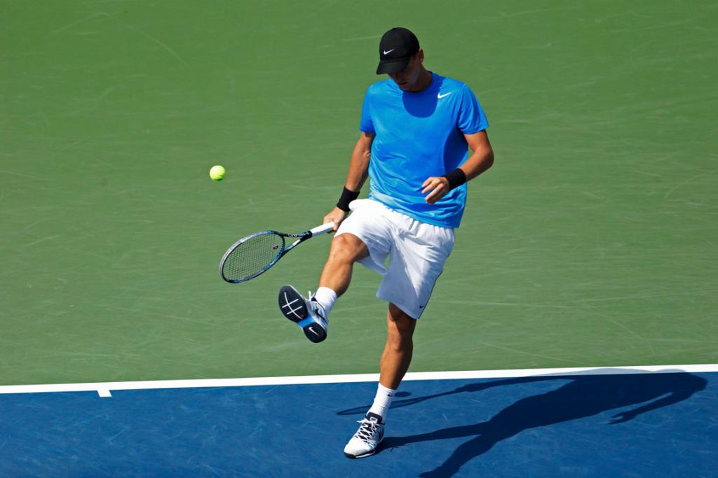 Tomas Berdych of the Czech Republic kicks the ball out of frustration during his semifinal loss to Andy Murray.