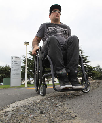 MORE OBSTACLES: New Zealand Spinal Trust worker Luke Kenmare attempts to navigate his way around damaged footpaths.