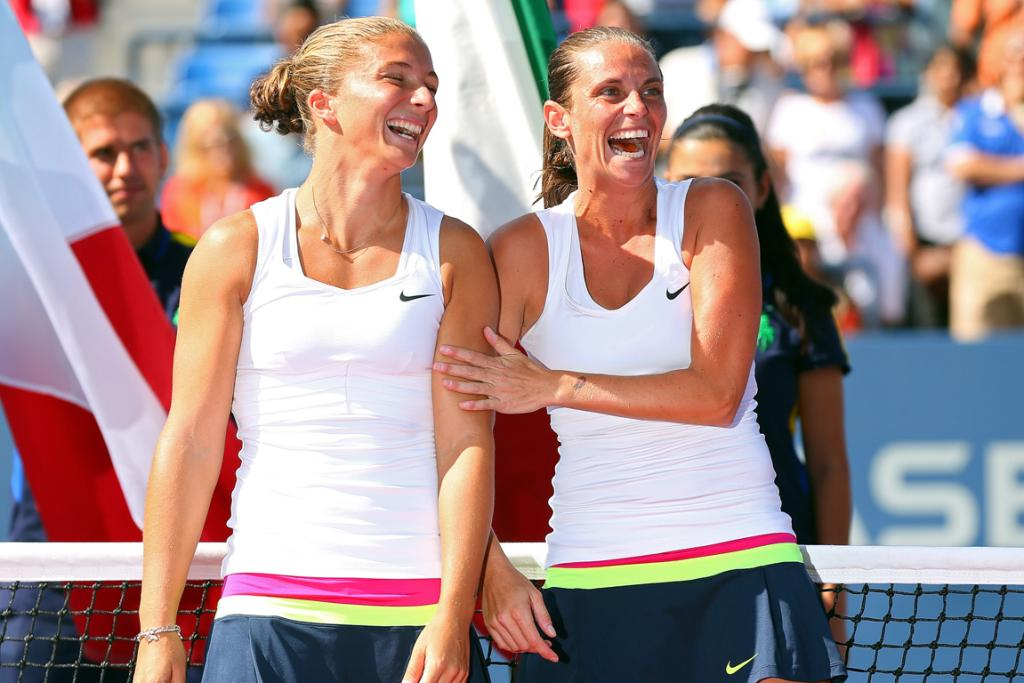Sara Errani and Roberta Vinci are all smiles as they receive the women's doubles trophy at the US Open.
