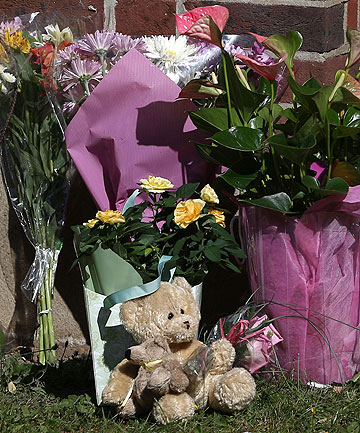 MESSAGES OF SUPPORT: Floral tributes and a teddy bear from well wishers are placed at the house of the al-Hilli family in Claygate, England.