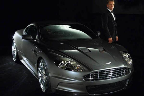 James Bond actor Daniel Craig poses for photographers with the Aston Martin DBS for the filming of Casino Royale (2006).