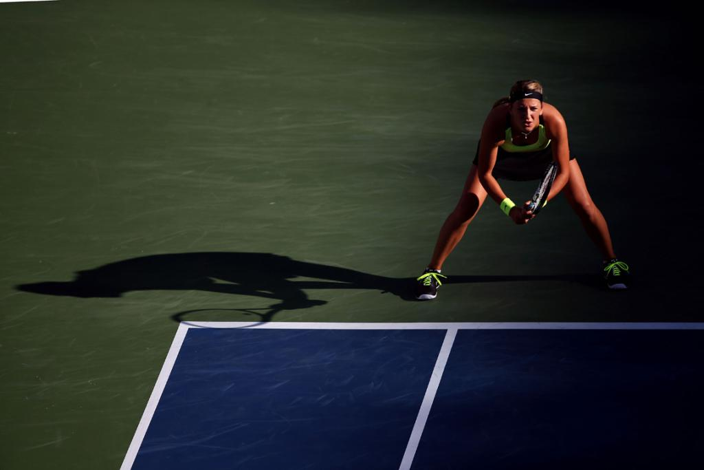 Victoria Azarenka waits for Serena Williams to serve during the women's final.