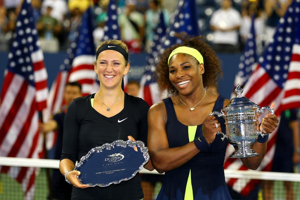 Serena Williams and Victoria Azarenka pose for photos after the trophy presentation.