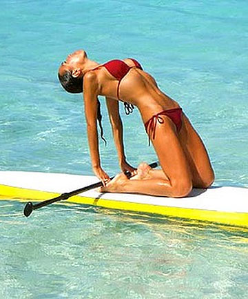 SUN SALUTE: Charlotte Piho shows how paddleboard yoga is done.
