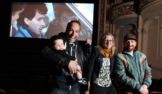 NOW SHOWING: Two Little Boys director Robert Sarkies, left, his partner, producer Vicky Pope, their 6-month-old son Max Sarkies, and writer Duncan Sarkies check out the setup for the film's premiere at Invercargill's Civic Theatre.