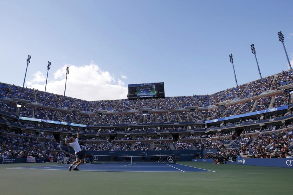 Andy Murray serves to Novak Djokovic in front of packed Arthur Ashe stadium.