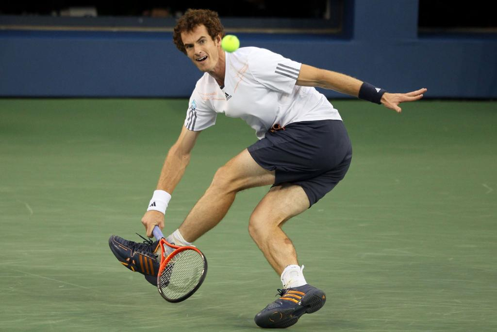 Andy Murray returns a shot during his men's singles final match against Novak Djokovic.