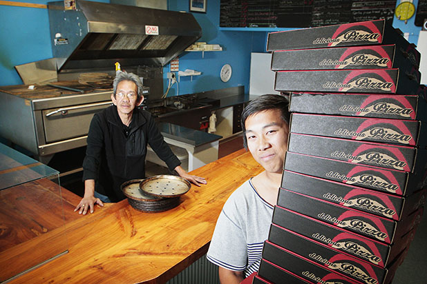 A TRIBUTE:  Benny Tjan, left  and his grandson Mike Gunawan in  Mykonos Pizza in Paeroa which is back in operation this Thursday.