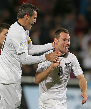 GOAL TIME: Ryan Nelsen celebrates the opening goal with Shane Smeltz during the All Whites clash with the Solomon Islands.