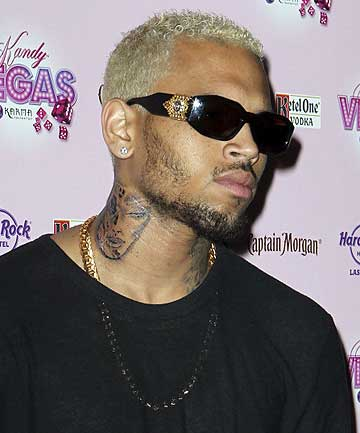 NEW TATTOO: Chris Brown has  a new neck tattoo that looks like the battered and bruised face of his ex-girlfriend Rihanna.