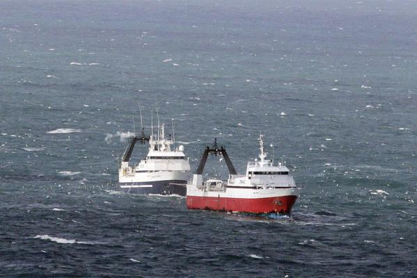 RESCUE: The Amaltal Columbia, red hull, on fire off the Canterbury coast. The San Discovery stands by.