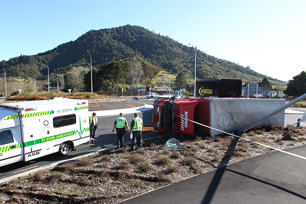 Emergency services staff at the scene of an accident on State Highway 1 at Taupiri where a freight truck has overturned.