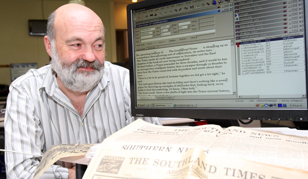 NEWS AND OLDS: Southland Times journalist Michael Fallow, approaching deadline on a history of the newspaper on the brink of its 150th anniversary.
