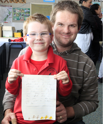 Family values: Redwoodtown School new entrant Ollie Eyles holds a letter retrieved from the school's time capsule written by his father, Rick Eyles, 25 years ago about a soccer game.