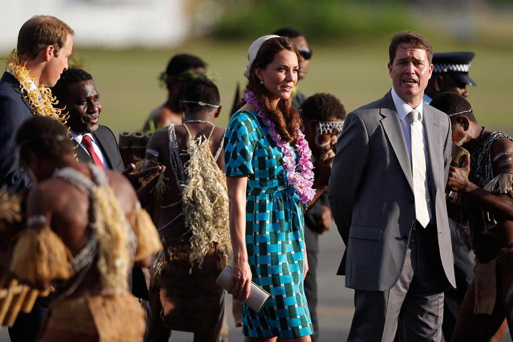 Prince William speaks to Solomon Islands' Prime Minister Gordon Darcy Lilo, second left, as they arrive for a short tour.
