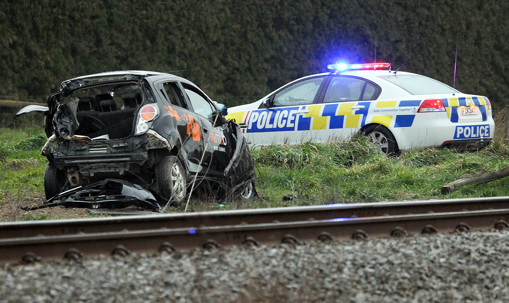 A woman has been freed from a car after it collided with a train in Mid Canterbury.
