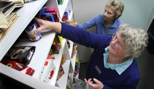 Mary Brown, (front) and Jean Woodall, of St Vincent de Paul, pack food parcels.