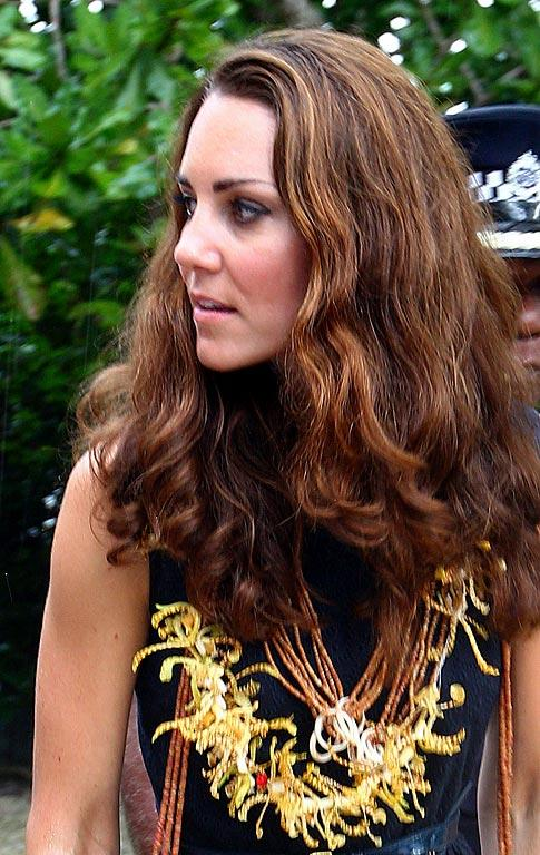 Kate Middleton wears a garland of orchids as she arrives in Tavanipupu, Solomon Islands.