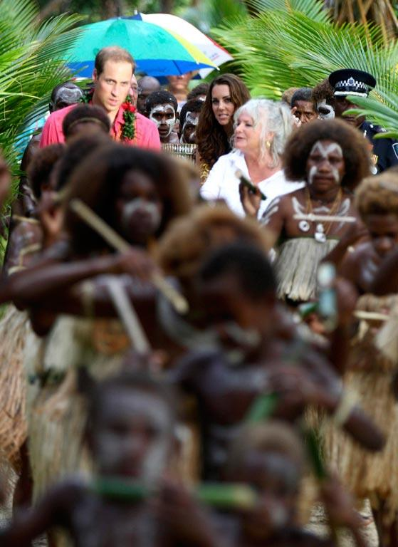 William and Kate are led by singing and dancing villagers in Tavanipupu, Solomon Islands.