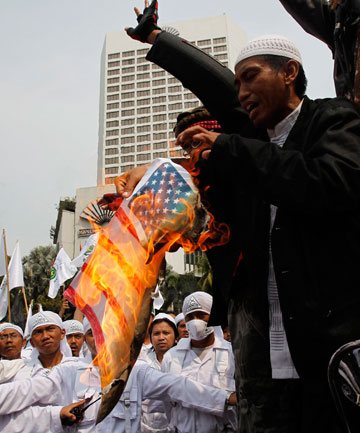 ANGER: Muslim protestors burned US flags and hurled rocks and molotov cocktails at the US embassy in Jakarta in protest over the anti-Islam film.