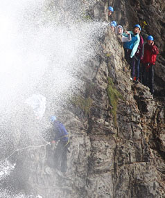 Three people died after falling into the sea during a Topec-run traverse of Paritutu rock.