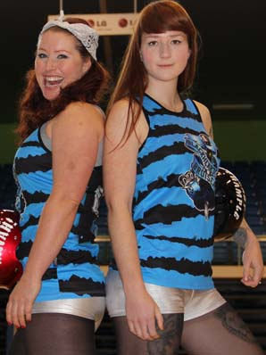 HIGH ROLLERS: Blackheart Bruisers' ''Pinot Mwah'', left, and ''Lady Trample'' are ready for the roller derby final showdown at Trusts Stadium.