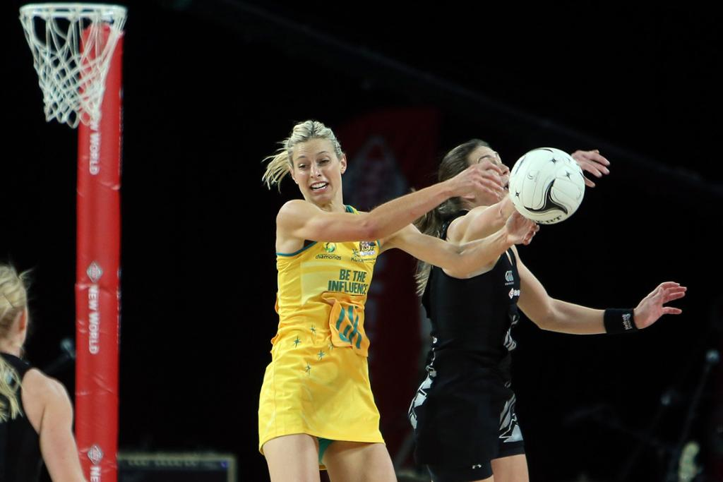 Irene Van Dyk and Laura Geitz in action during the second netball test match at Vector Arena.