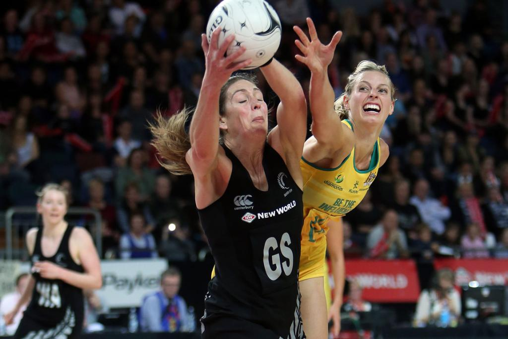 Irene Van Dyk and Laura Geitz compete during the second netball test match at Vector Arena.