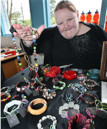 LABOUR OF LOVE: Samantha Morton, 19, displays jewellery for sale at her stall during the Ruru Specialist School's market day extravaganza at Waikiwi to help raise funds for Coastguard Bluff.
