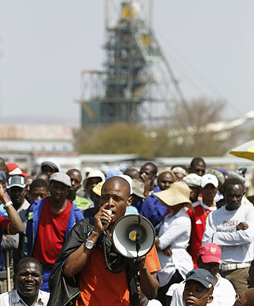 BLOODY STRIKE: A mineworker addresses his workmates before taking part in a march outside the Anglo American mine in South Africa's North West Province last week.