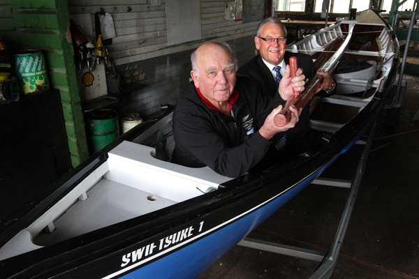 Rowing away: Swiftsure boat builder Ron Perano and Marlborough Mayor Alistair Sowman lift in the boat's new steering oar after the original oar was sent on its way to Marlborough, England.