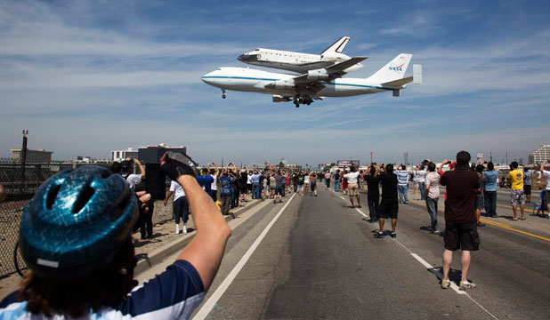 All eyes and lenses turned upwards in Los Angeles as the space shuttle Endeavour, piggybacked on a 747, landed for the last time.
