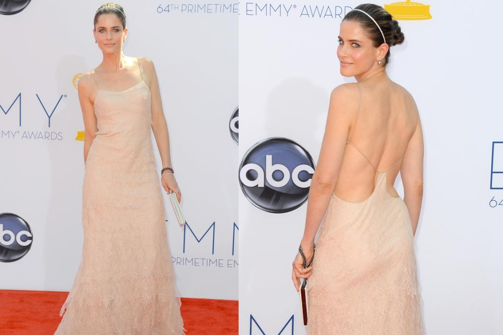 Is Amanda Peet having a wardrobe malfunction? No, she's just making sure her dress is still attached at the back.