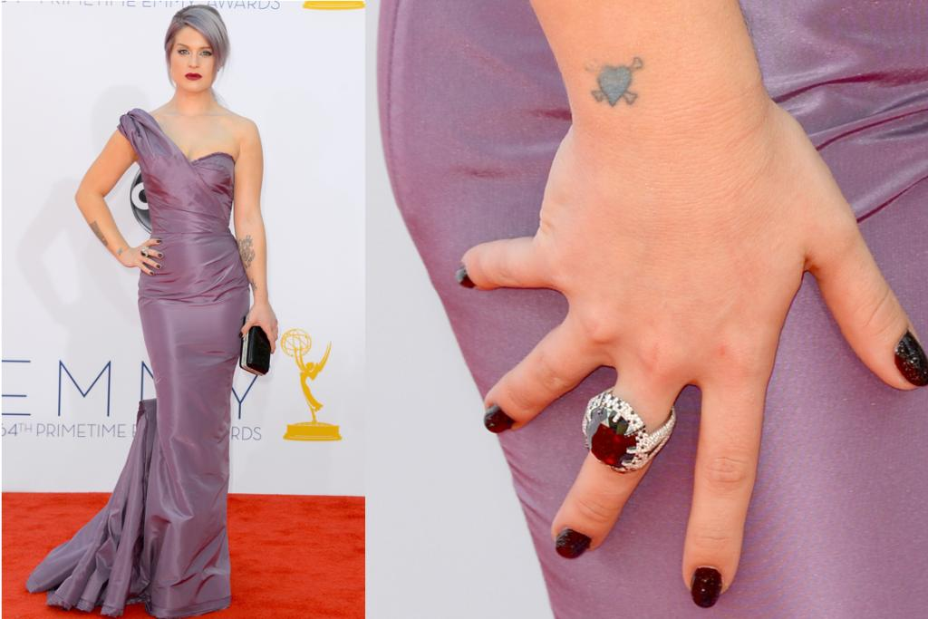 Kelly Osbourne matches her dress to her hair and her ring to her nails, but those tattoos don't go with anything.