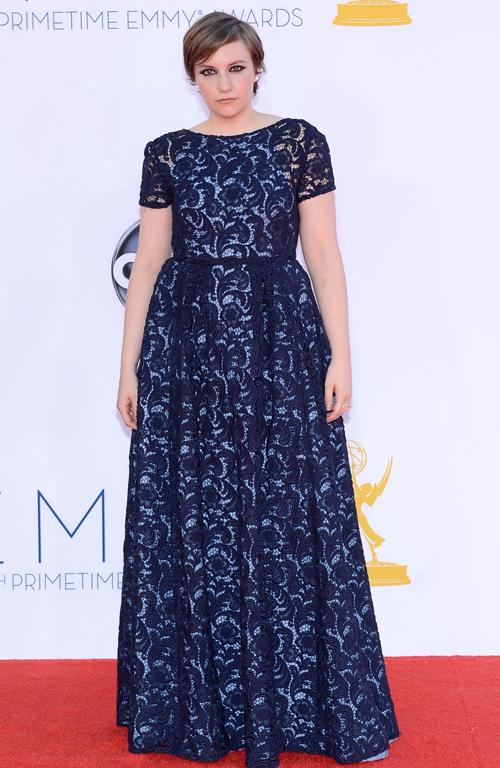 Oh dear, Lena Durham has obviously been taking 'how to look awkward on the red carpet' lessons from Kristen Stewart. As for the dress...