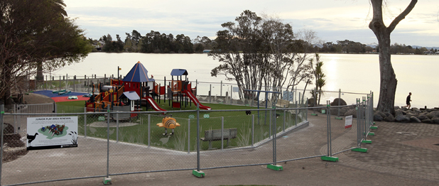 OFF-LIMIT: The playground was fenced off for refurbishment in August but it appears some families couldn't wait any longer to get in.