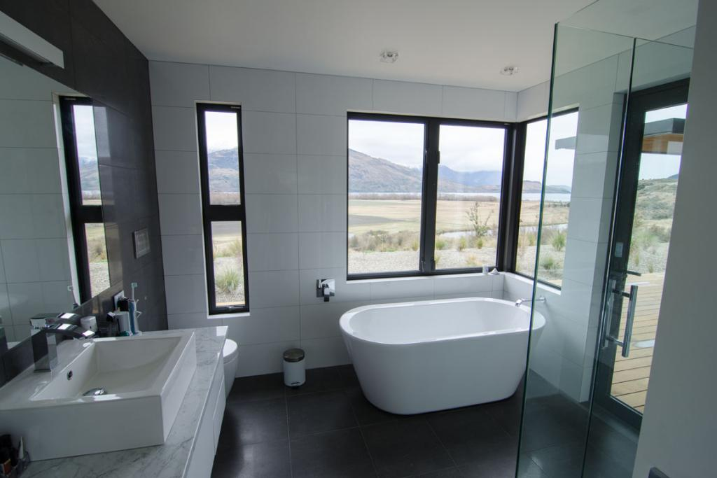 The master bedroom ensuite boasts luxury bathing, with a view that stretches from mountain tops to stream.