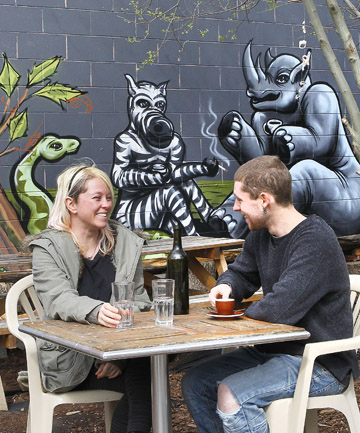 Murals are a feature of the garden out the back of Newtown's Cafe Baobab.