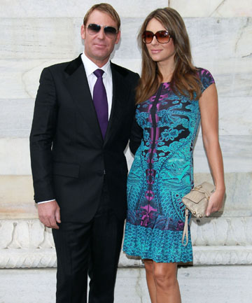 THE HURLEY EFFECT: Shane Warne and Elizabeth Hurley pose for photographers at Milan Fashion Week.