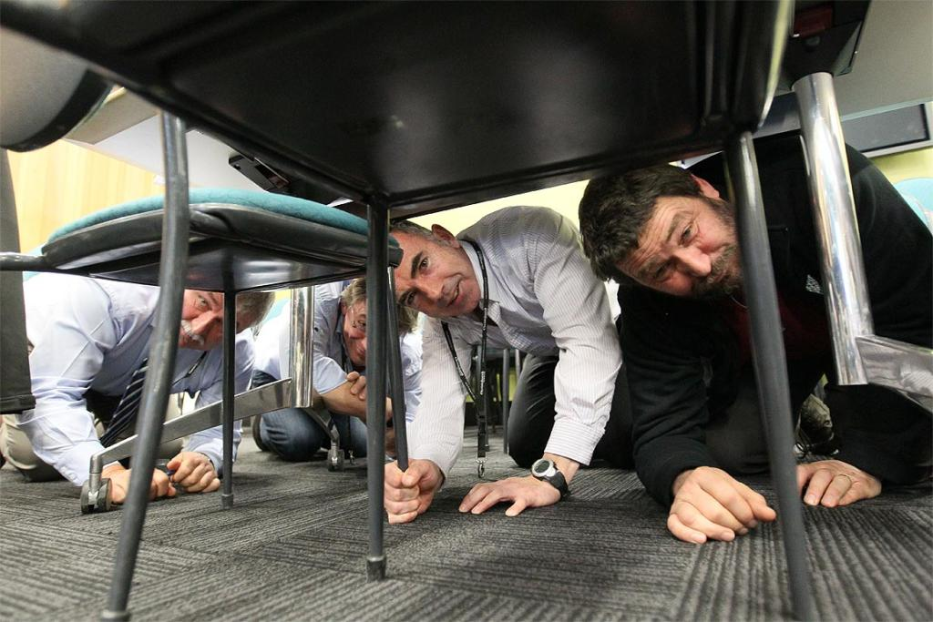 Team Leaders at Christchurch's city council have their meeting interrupted by the drill. From left: Warren Murphy, Paul Meek, Paul Burden and Jeremy Hawker.