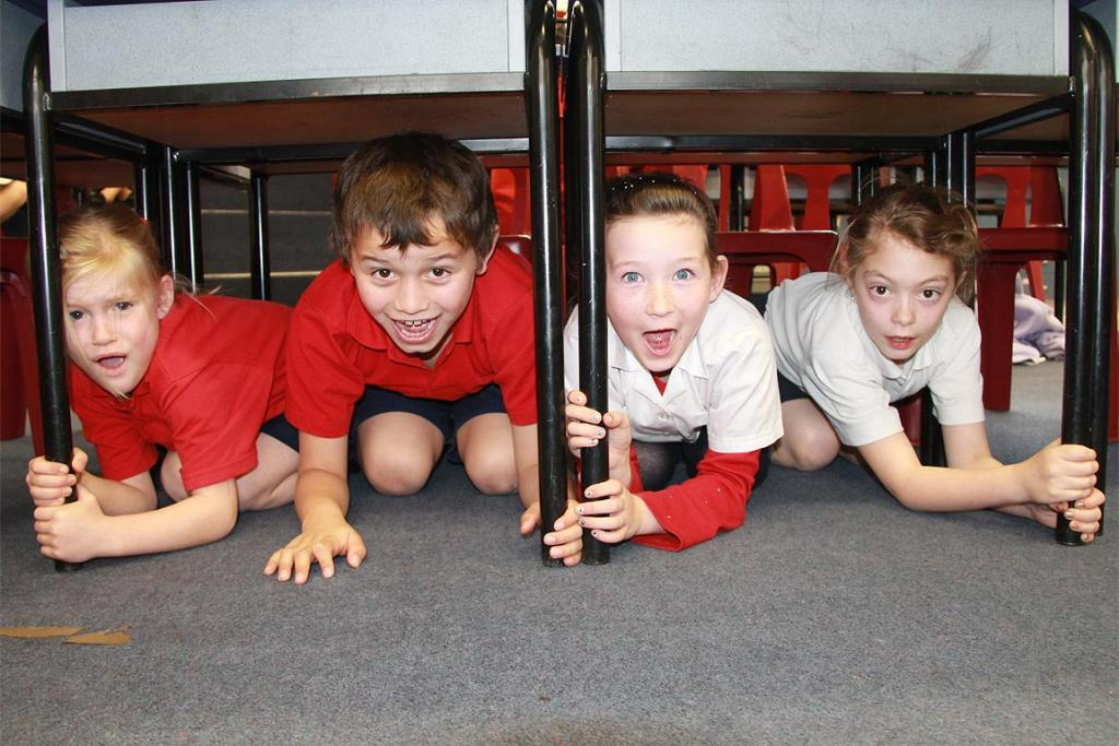 West Gore School students Isobel McDonald, Tane Heteraka, Crystal Normington and Maxine Cartwright take part in the national earthquake drill.