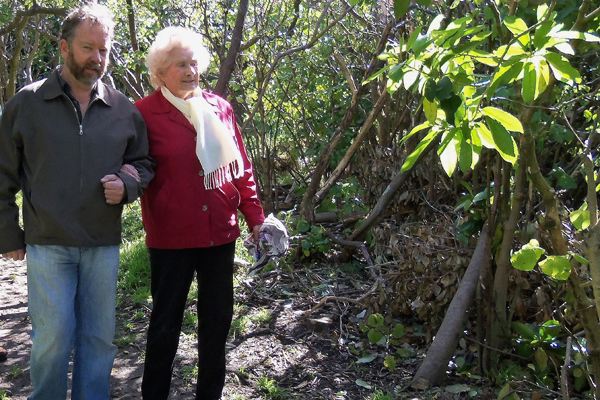 Restoration work: Allan Jenkins and Lillian Young decide where to plant new karaka trees in the Rangitatau reserve.