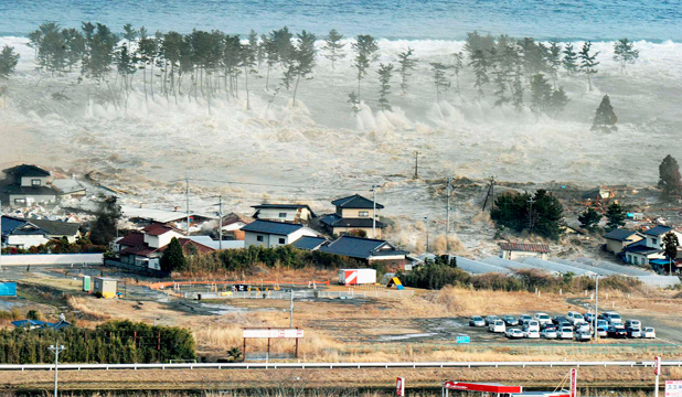 DEVASTATED: The Natori city in Miyagi prefecture, Japan, is hit by a tsunami on March 11, last year. Scientists now believe large earthquakes can trigger other quakes in far-away locations.