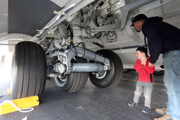 Mark Smith and his four year old son, Sam, take a look at the workings of the US airforces C-17 Globemaster in Christchurch today.