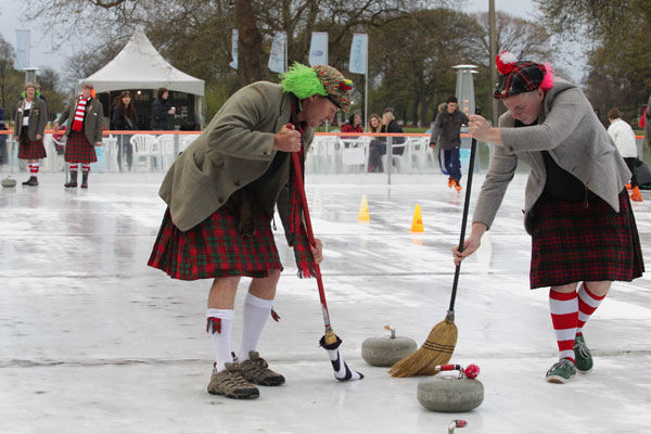 Tony McEnaney left and Toby OSulluvin sweep in front of the stone watched by Brent Stanton. Members of West coast Curling club held a curling competition at the Ice rink at Ice fest on Saturday night