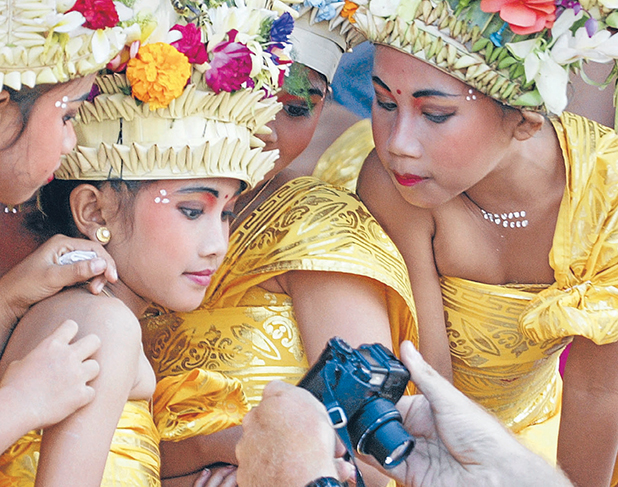 PHOTOGENIC: The Balinese people are an integral part of the island's beauty and have embraced the outside world's interest in their culture.