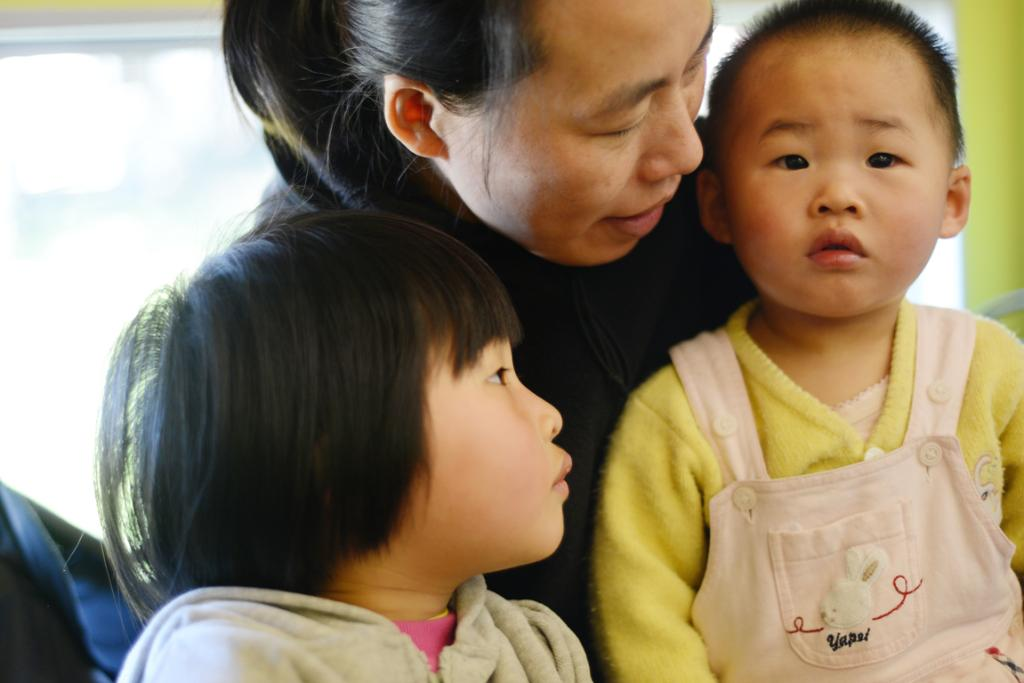 Three-year-old Grace Cao, left, with her mum Feng Shu Qiu and her 18-month-old baby sister Selina at the Baby Rock and Rhyme programme. The group, for children aged 0 to 2, is held every Friday during the school term. It is an interactive session of rhymes and songs.