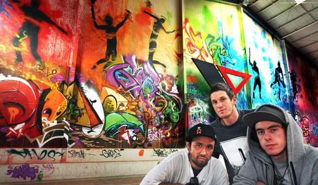 From left, Jesse Geary, Nick Tam and Danny Owen in front of the mural they have created at the YMCA.