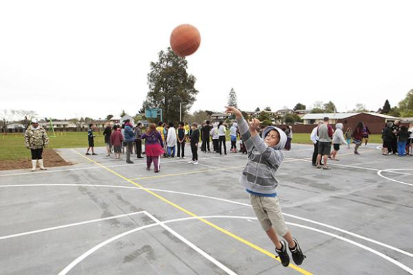 THE MOVES: Lennox King, 9, takes a shot at goal on a new basketball court just opened at Crawshaw Park, in Nawton, Hamilton.