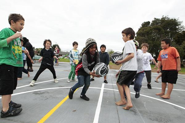 FUN: Children try out the new court.
